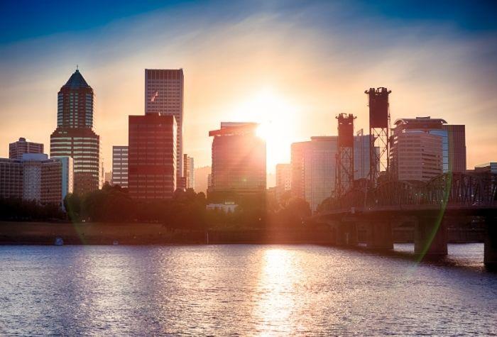 Portland Oregon city with a colorful sunset sky, Buyers Agent Portland