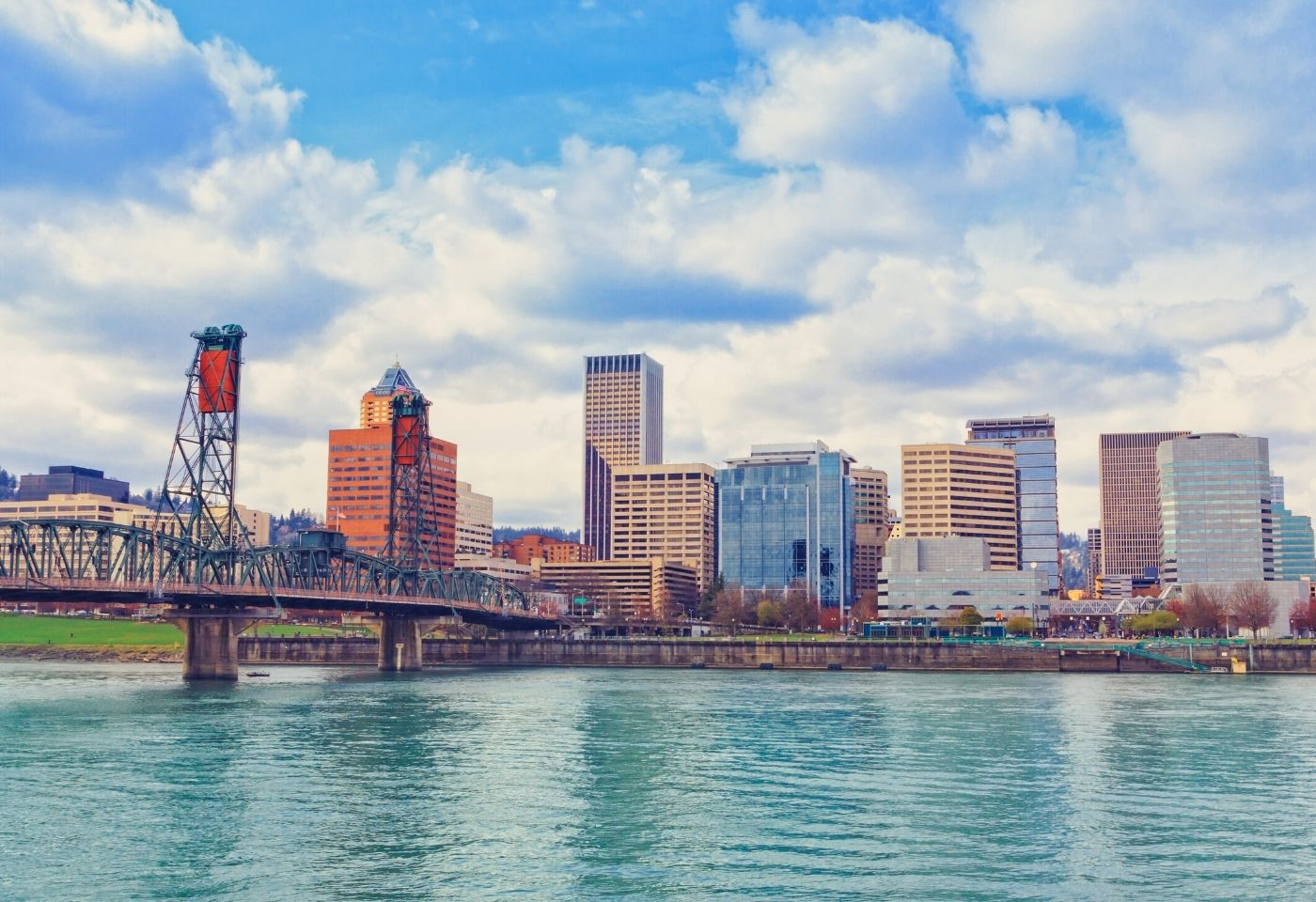 Downtown Portland Oregon on the Willamette River with a bridge, Buyers Agent Portland